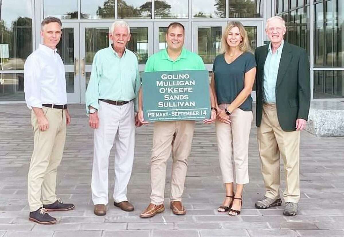 Candidates for Guilford's Board of Education running under the slate Republicans for Education stand outside Guilford High School. From are Bill Mulligan, Jim O'Keefe, Joseph Golino, Amy Sullivan and Ted Sands.