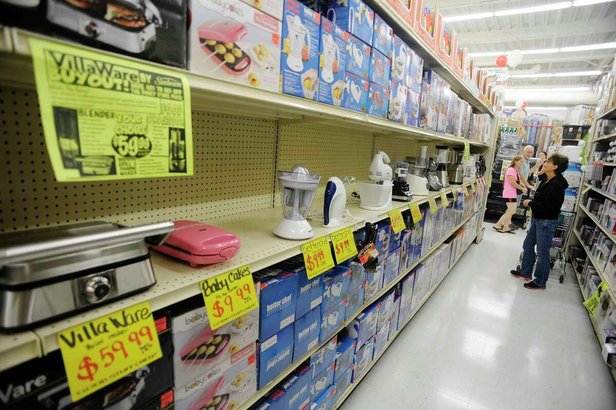 """Customers shop for housewares during the grand opening of Ollie's Bargain Outlet at Crossgates Commons on Wednesday, Aug. 21, 2013 in Albany, NY. This is the 145th store for the chain, which bills its self as an extreme discounter of name brand items. """"It's all about making the dollar stretch for consumers"""" said Scott Osborne, director of stores for the chain. (Paul Buckowski / Times Union)"""