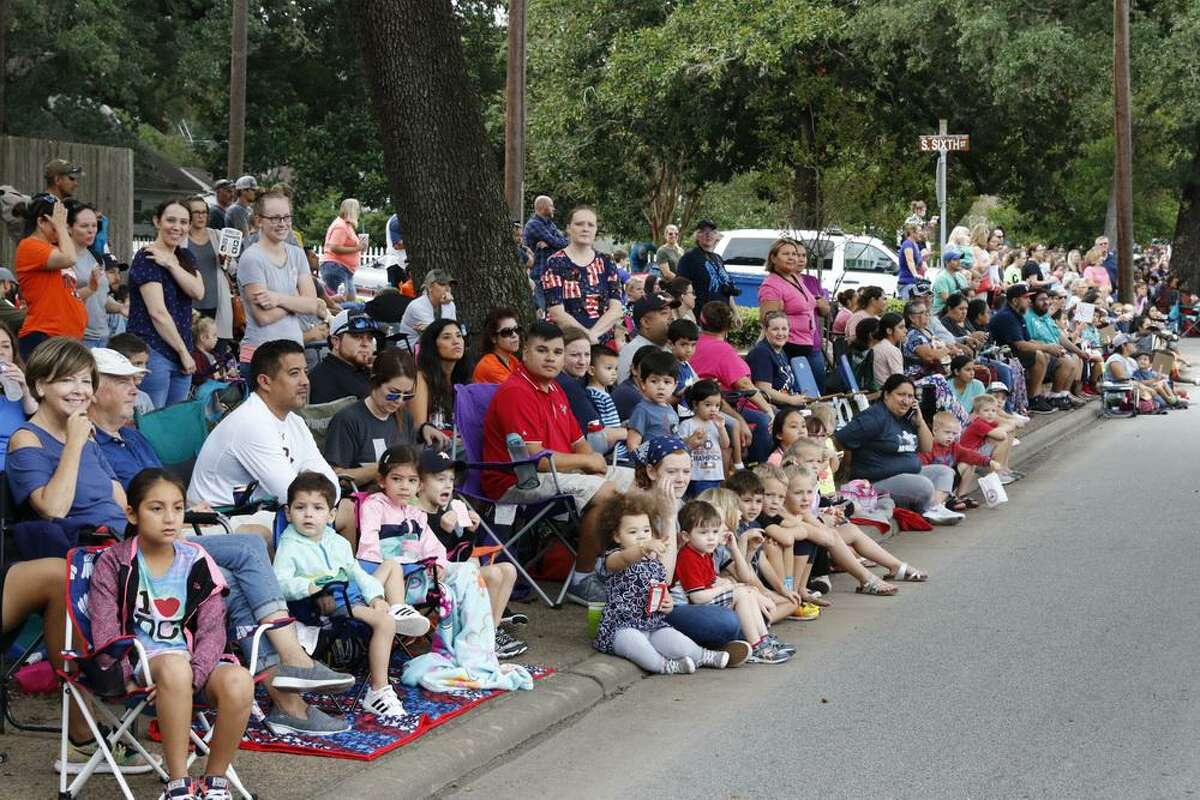 The Fort Bend County Fair and Rodeo has canceled several events this year, including its Parade, to align with recommendations from county officials due to an uptick in the COVID-19 delta variant. Here, the 2019 parade crowd takes in the show.