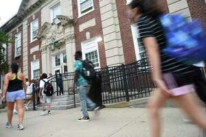 Students enter the first day of school at Stamford High School in Stamford, Conn. Monday, Aug. 30, 2021.