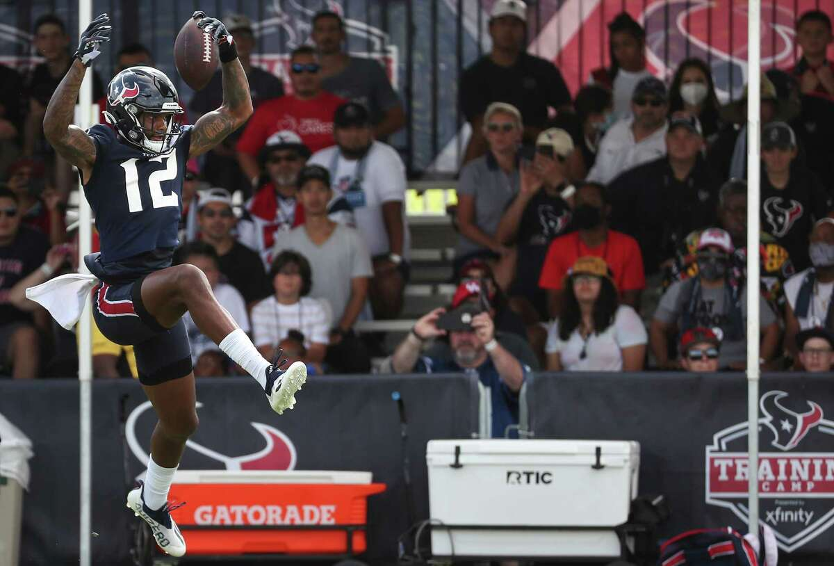 Houston Texans wide receiver Nico Collins (12) leaps up to make a catch in front of the fans during an NFL training camp football practice Monday, Aug. 2, 2021, in Houston.