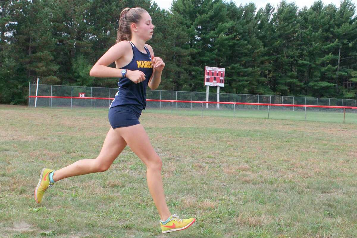 Cecelia Postma sprints to the finish during a county meet at Bear Lake