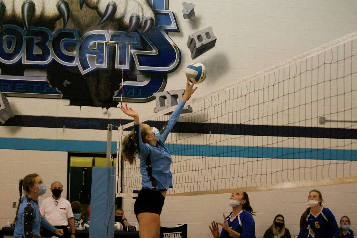 Sophia Fischer makes a play at the net during a home match against Evart last year.