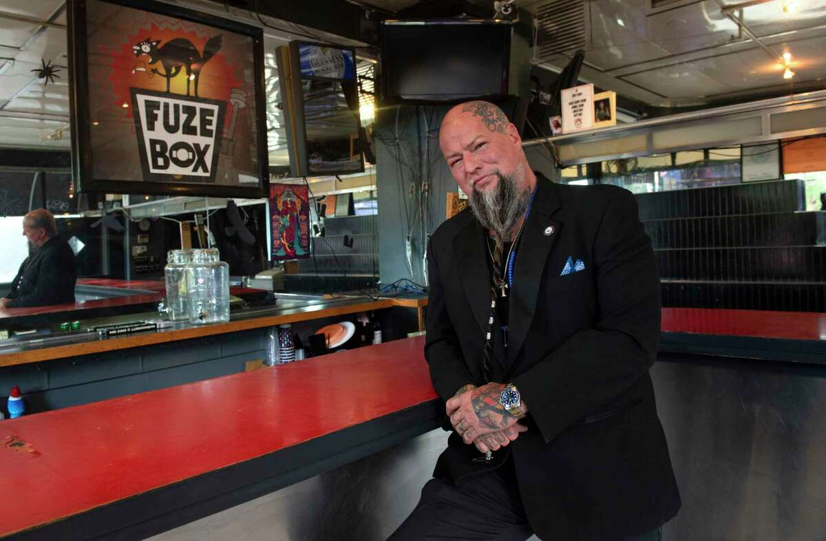 """Entrepreneur William """"Tragedy"""" Yager stands inside the Fuze Box building on Friday, Sept. 10, 2021 in Albany, N.Y. Yager, who owns barbershops, tattoo parlors, a laundromat and mead bar, has purchased the building and intends to revitalize it."""