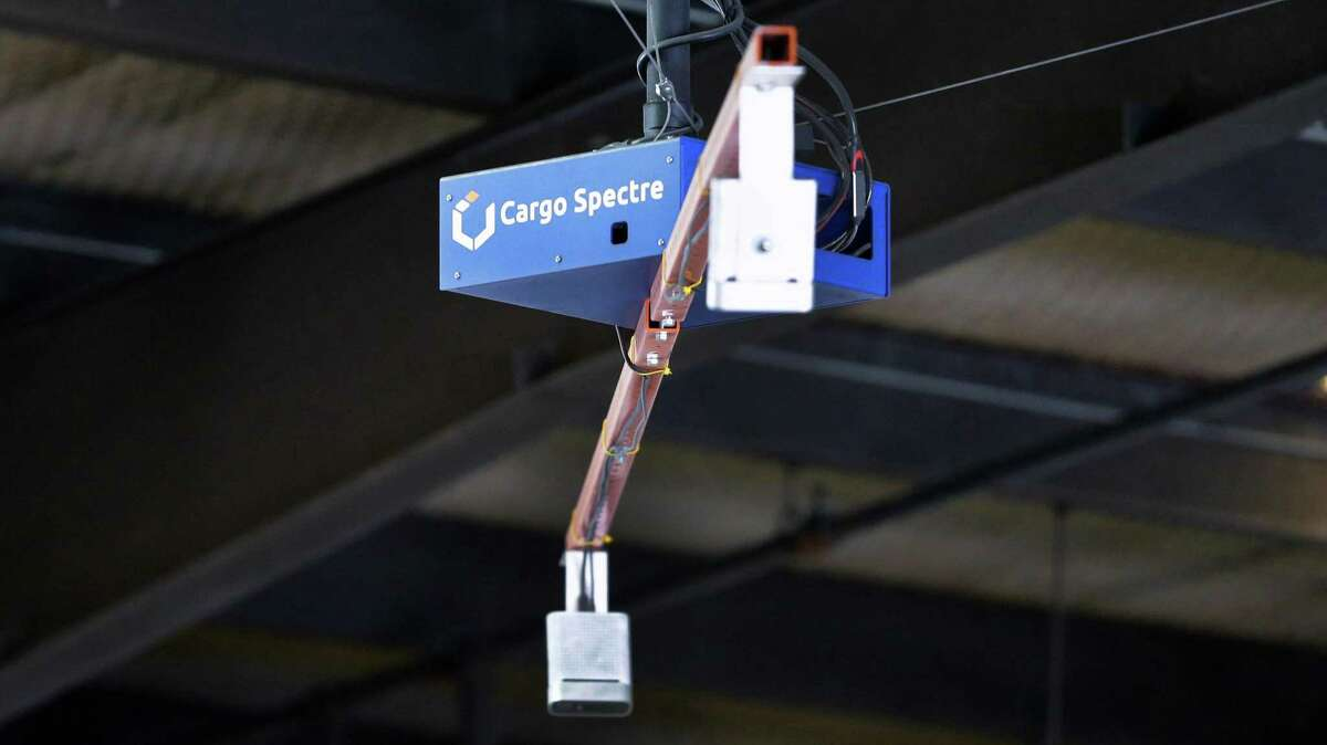 The Cargo Spectre apparatus, suspended from the ceiling over a scale where freight pallets are placed, has sensors and lights to fully automate instantaneous weight and measurements data of the pallets in the warehouse at World Trade Distribution Thursday, Aug. 12, 2021 in Houston, TX.