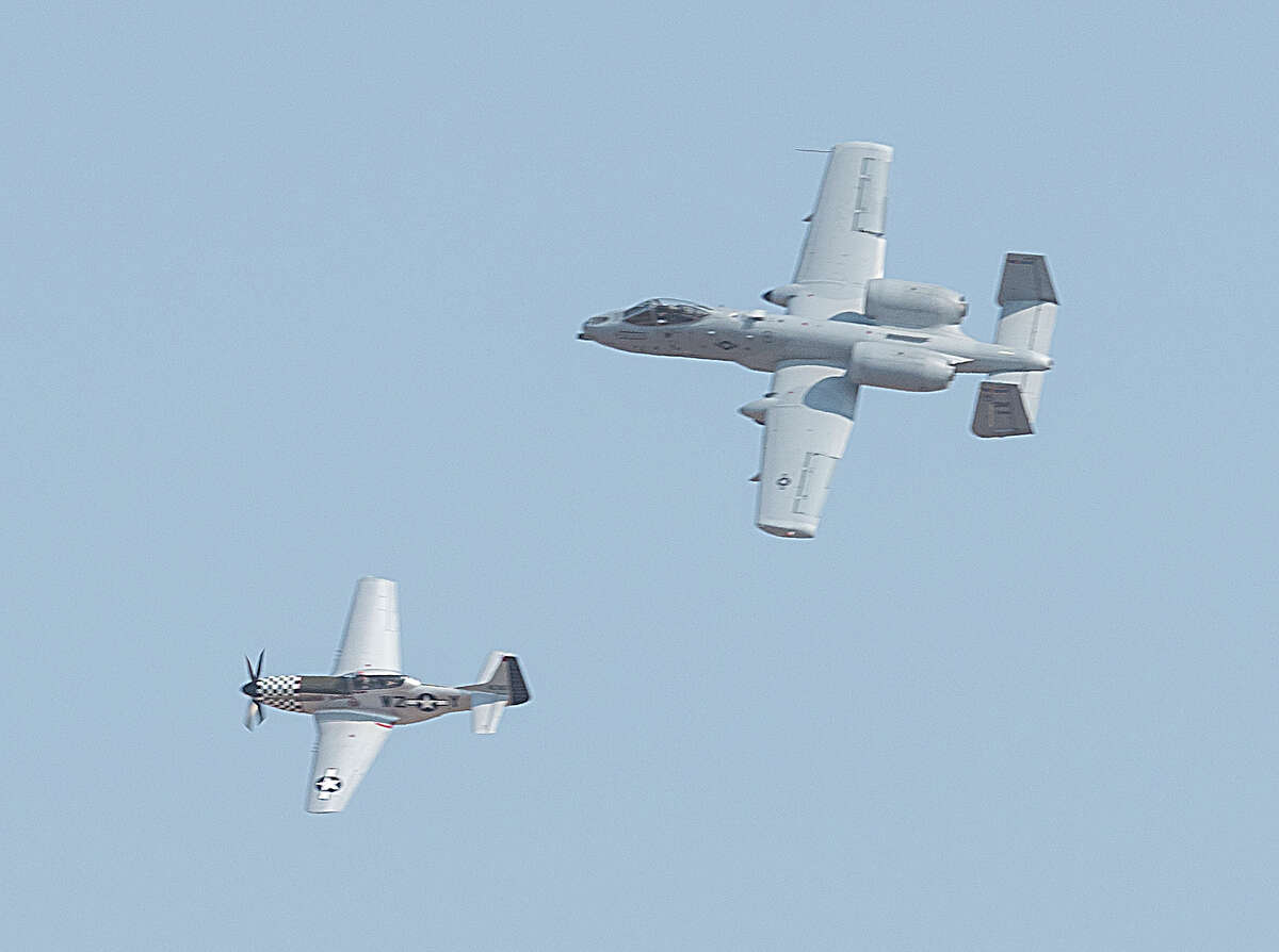 One of the A-10 Thunderbolt Demonstration Team flies in formation with a P-51 Mustang for a Heritage Flight during an AirSho preview 09/10/2021 for area school children and special friends of the CAF at Midland International Air and Space Port. Tim Fischer/Reporter-Telegram