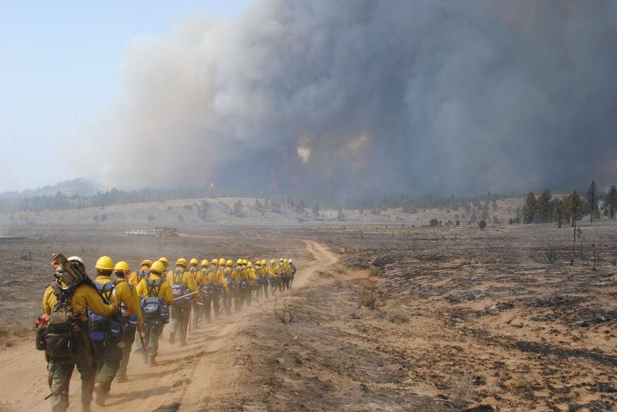 US Army soldiers enlisted as firefighters, march to the fire line of the Dixie Fire in California on Sept. 7, 2021.