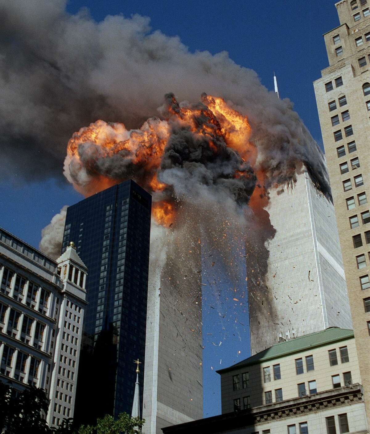 Smoke, flames and debris erupt from he World Trade Center towers on 9/11. Twenty years later, the pain endures as do reflections about how the attack changed our nation.