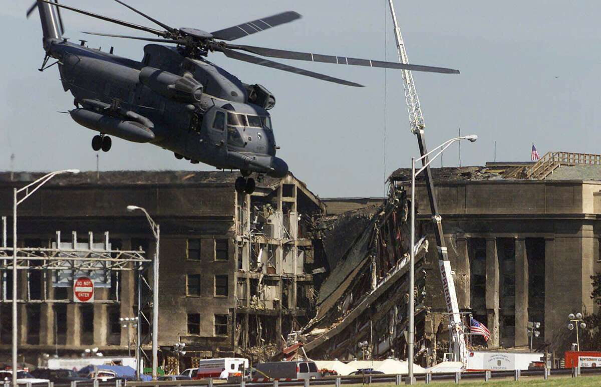 A helicopter ascends outside the Pentagon on Sept. 12, after the hijacked American Airlines Flight 77 crashed into the building.
