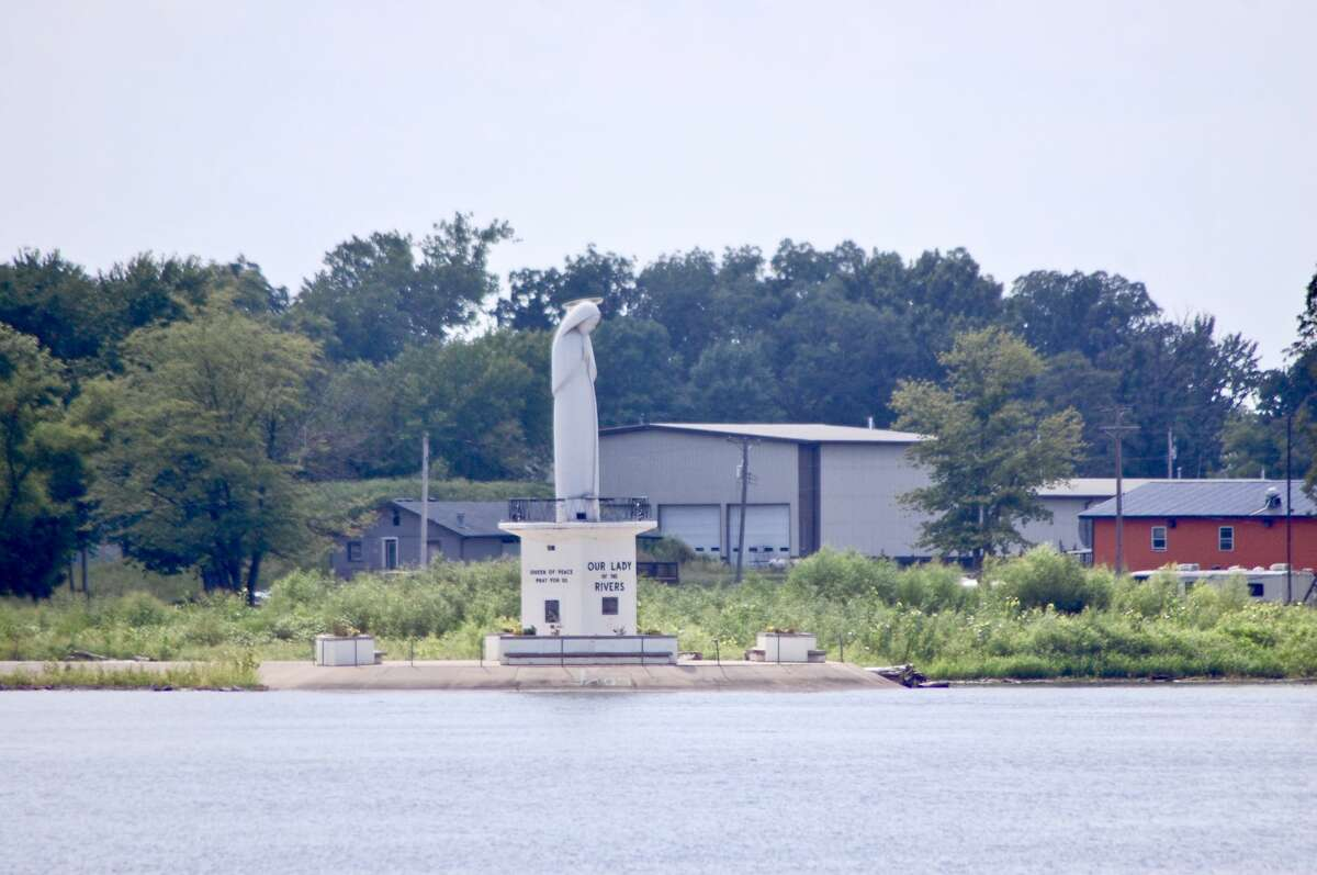 From a distance, the Our Lady of the Rivers statue is difficult to depict.