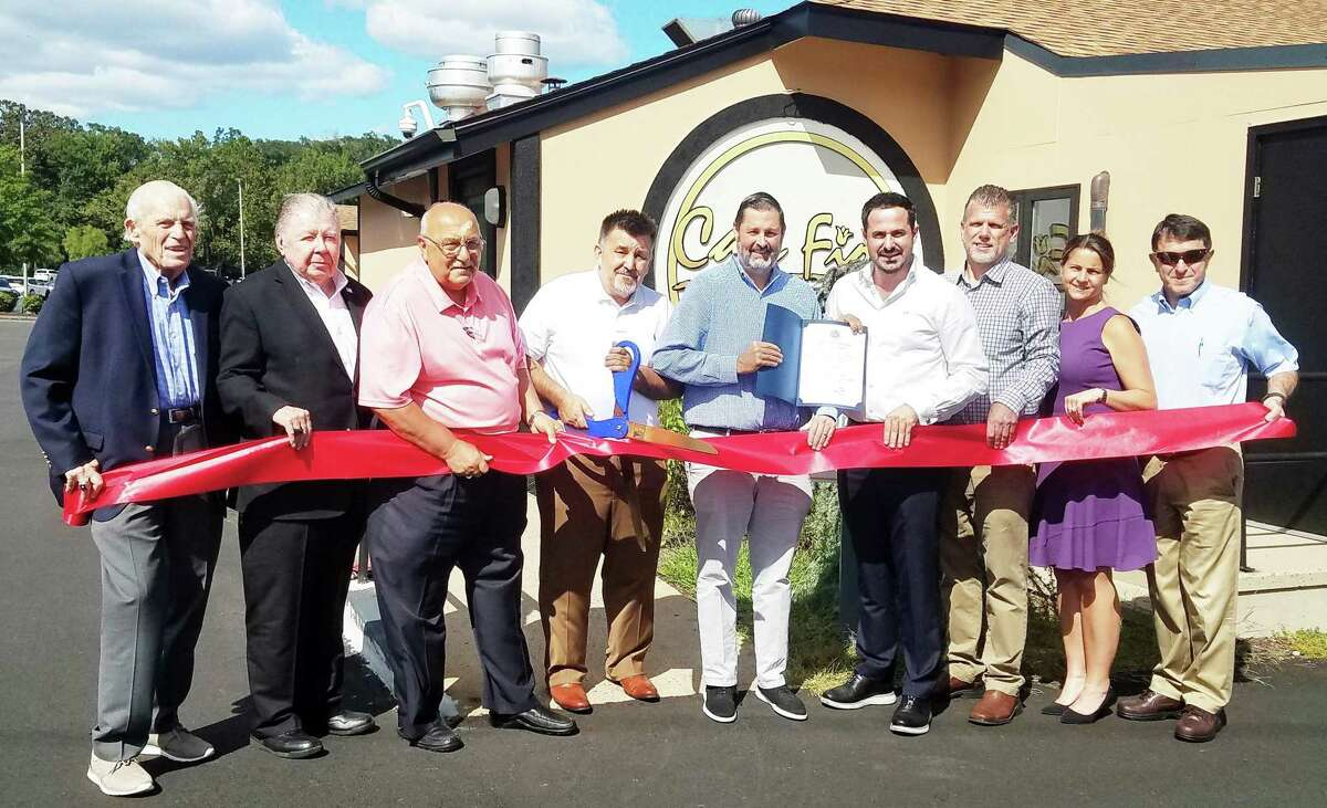 Café Fiore in Cromwell celebrated a grand opening Sept. 2. From left are Middlesex County Chamber of Commerce President Larry McHugh, past chairman Jay Polke, Town Manager Anthony Salvatore, owner Rusit Cecunjanin, Mayor Enzo Faienza, restaurant manager Valon Avdimetaj, Chamber Cromwell Division Chairman Rodney Bitgood, state Rep. Christie Carpino, R-Cromwell, and Town Planner Stuart Popper.
