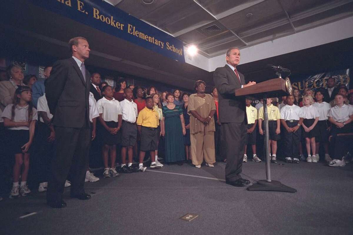 President George W. Bush issues brief remarks to the nation from the library of Emma Booker Elementary in Sarasota, FL on the morning of Sept. 11, 2001 announcing that two planes had crashed into the World Trade Center in an apparent terrorist attock.