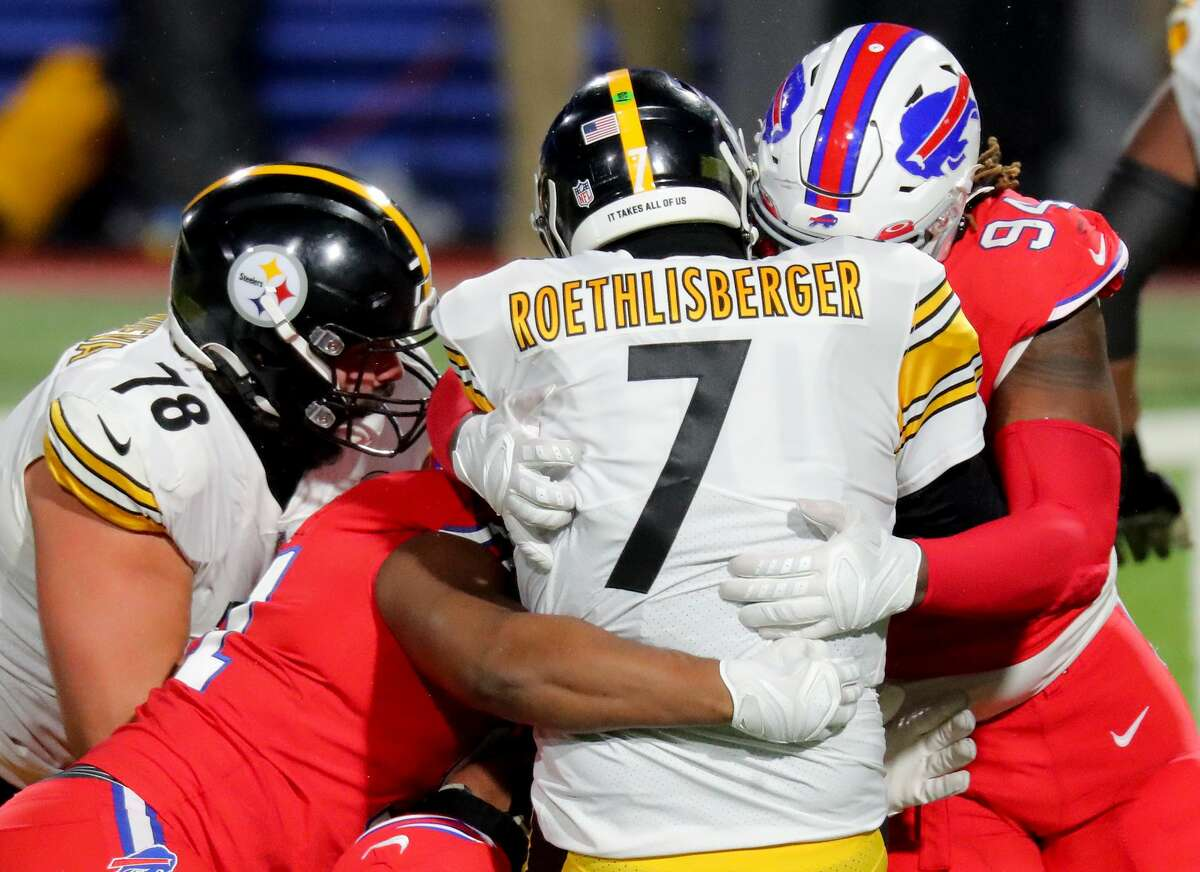 ORCHARD PARK, NEW YORK - DECEMBER 13: Ben Roethlisberger #7 of the Pittsburgh Steelers is sacked by Lee Smith #85 and Vernon Butler #94 of the Buffalo Bills during the third quarter in the game at Bills Stadium on December 13, 2020 in Orchard Park, New York.