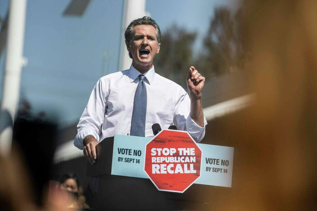 California Governor Gavin Newsom speaks on stage during a campaign visit with Vice President Kamala Harris against the upcoming gubernatorial recall election at thr IBEW-NECA Joint Apprenticeship Training Center in San Leandro, California Wednesday, Sept. 8, 2021.
