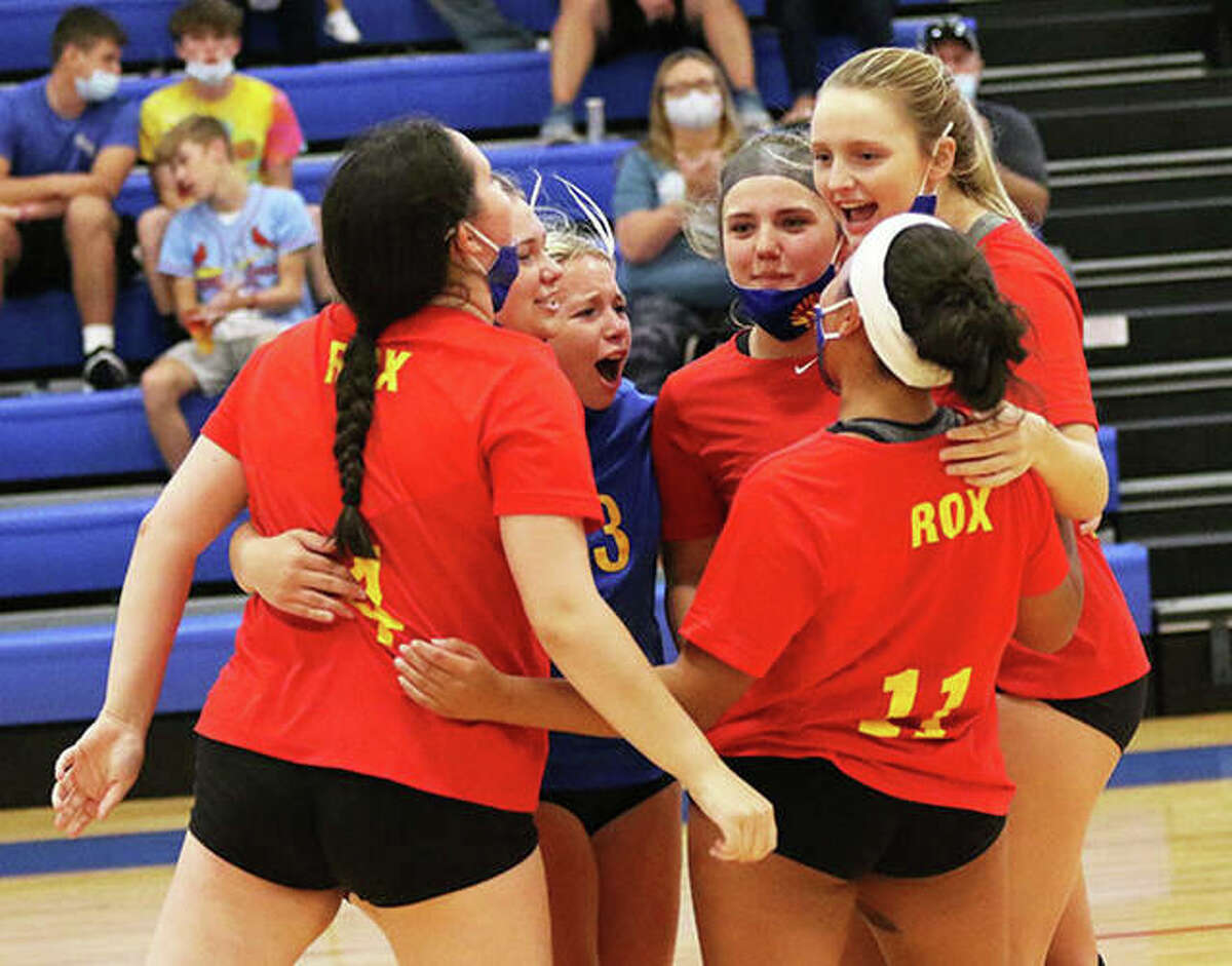 The Roxana Shells celebrate a point during a match in the Roxana Tourney last month. The Shells celebrated again Thursday night after a two-set win over rival EA-WR in a Cahokia Conference match in Roxana.