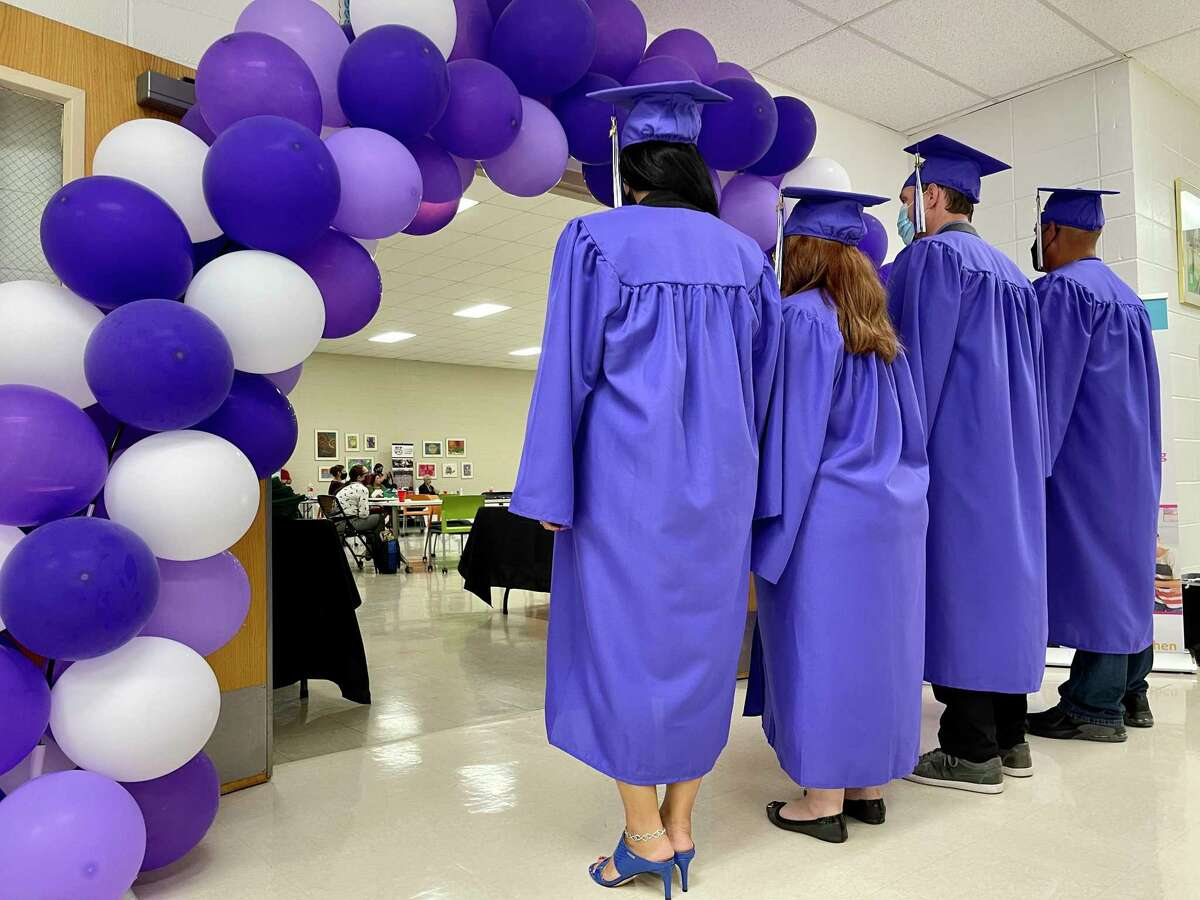 Reflejo is a new Bexar County court that gives a second chance to adults with a history of substance abuse charged with misdemeanor domestic violence. Here, four graduates celebrate.
