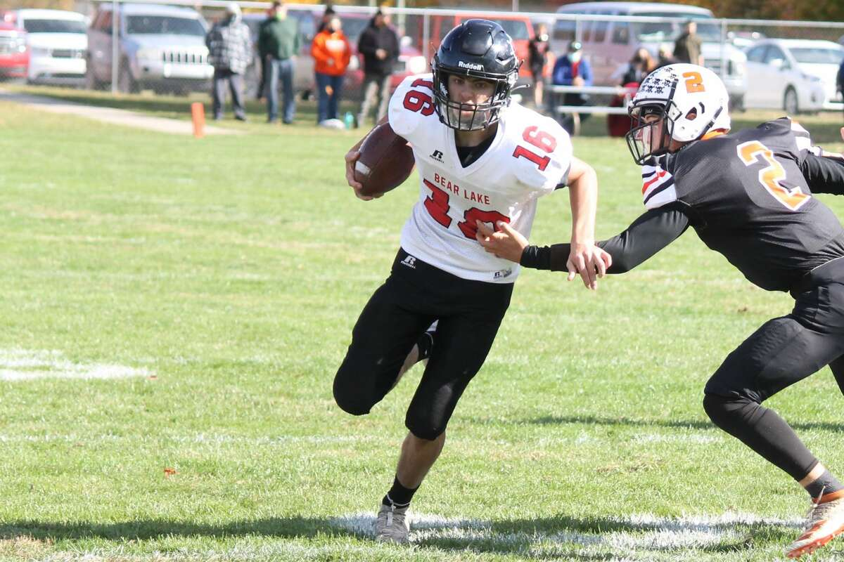 Bear Lake quarterback Bryce Harless sprints upfield in an attempt to score a touchdown against Mesick.