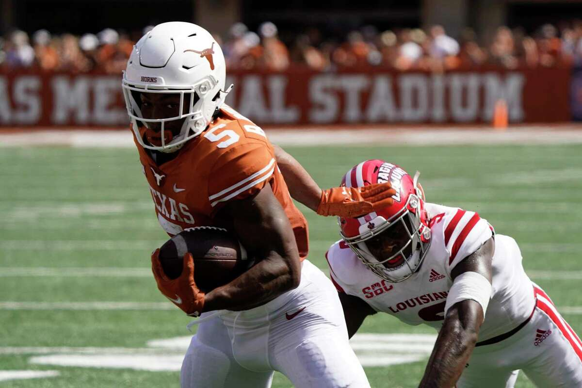Texas' Bijan Robinson (5) runs against Louisiana-Lafayette during the first half of an NCAA college football game on Saturday, Sept. 4, 2021, in Austin, Texas. (AP Photo/Chuck Burton)