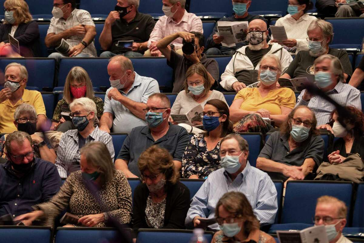 People are seen wearing face masks before a show in a theatre in The Egg at the Empire State Plaza on Thursday, Sept. 9, 2021 in Albany, N.Y.
