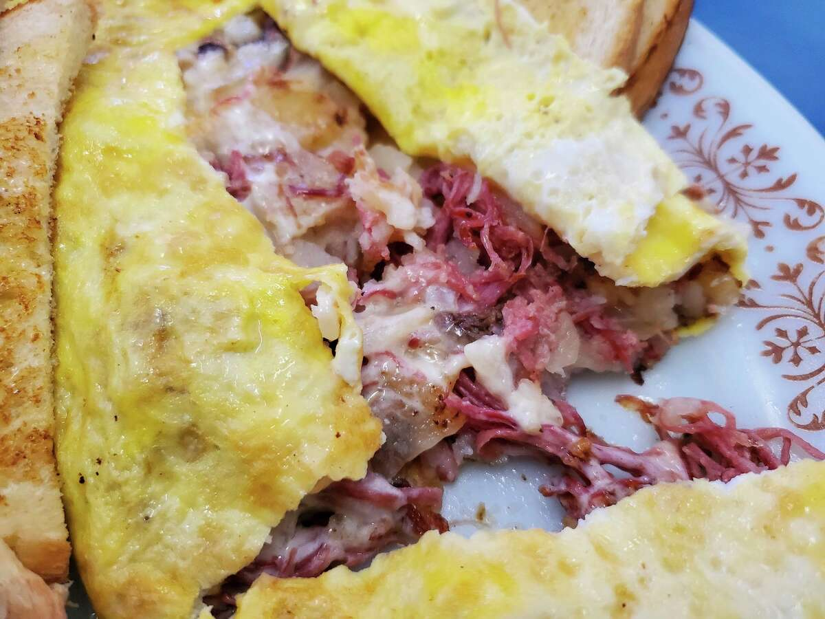 The rose colored homemade corned beef inside the Irish omelet is held together with the potatoes and onions by melted Swiss cheese.(Scott Nunn/Huron Daily Tribune)