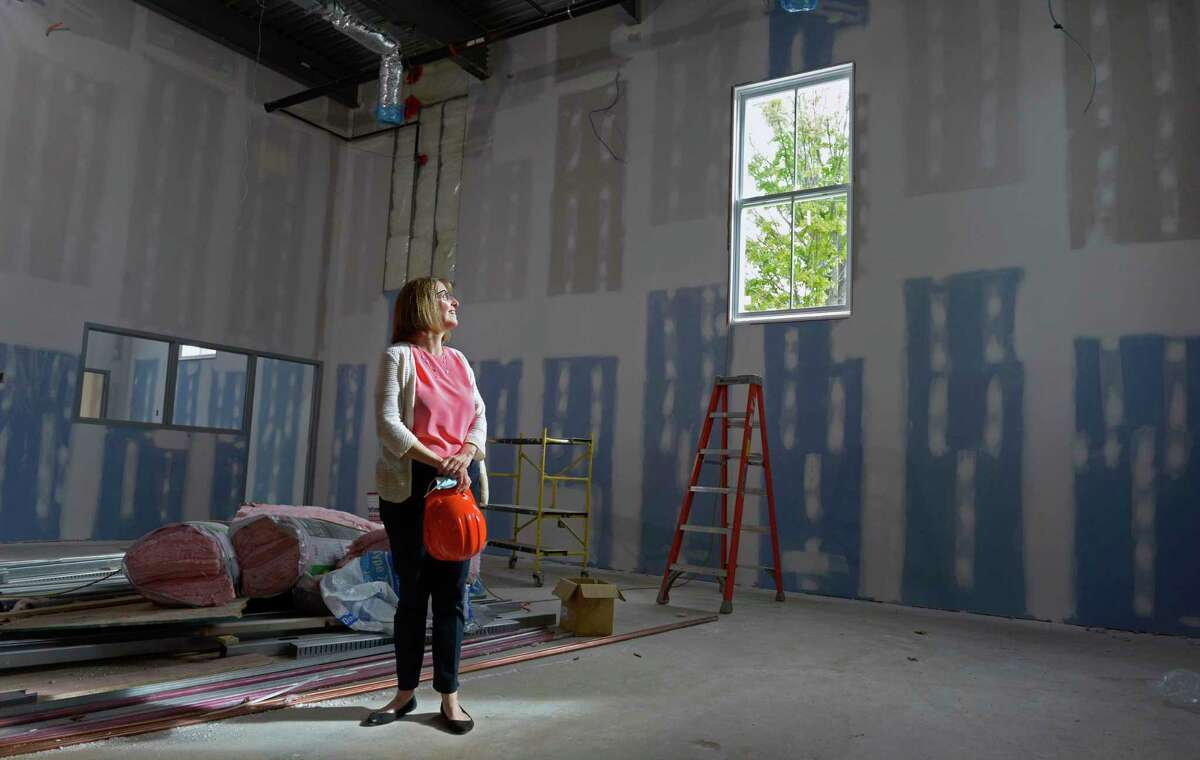 Lorna Rhyins, Library Director, stands in the new children's space of the New MilfordLibrary. The expansion and renovation construction work continues on the library. Friday, September 3, 2021, New Milford, Conn.