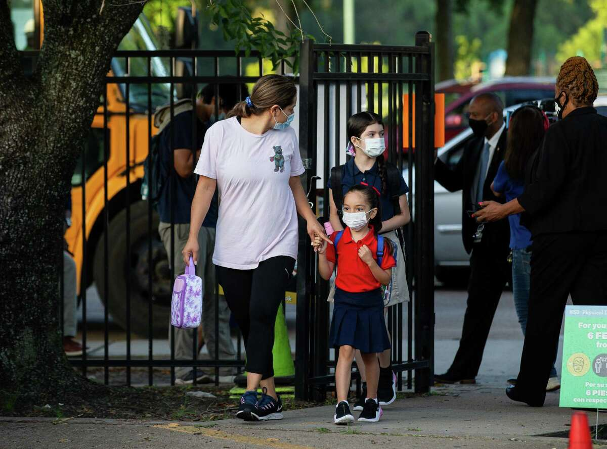 Students arrive for the first day of school at Benbrook Elementary School on Monday, Aug. 23, 2021, in Houston.