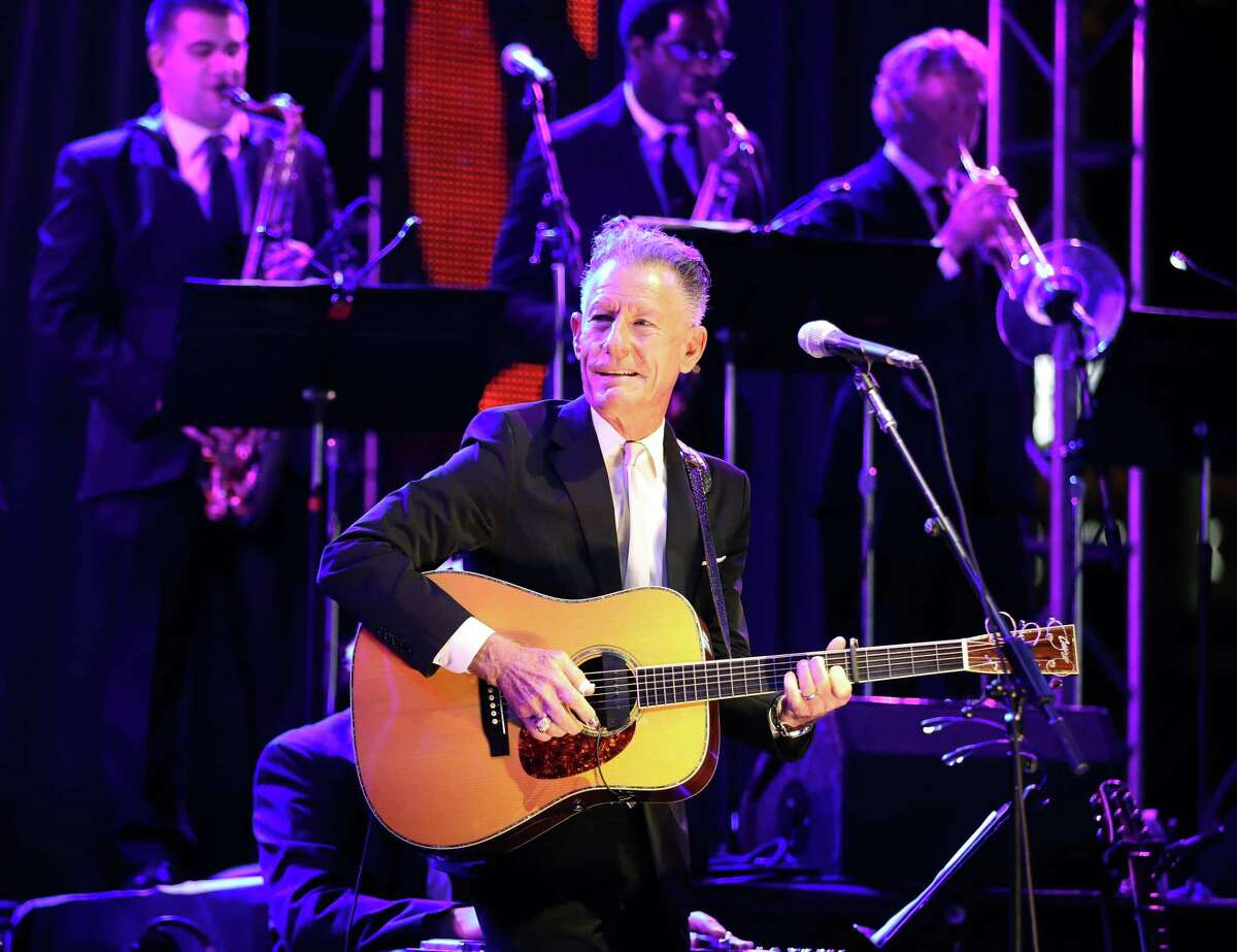 Singer-songwriter and Texas native Lyle Lovett and his Large Band performs during the Astros Foundation's sixth annual Diamond Dreams Gala presented by Chevron, on the field at Minute Maid Park, Thursday, September 9, 2021, in Houston.