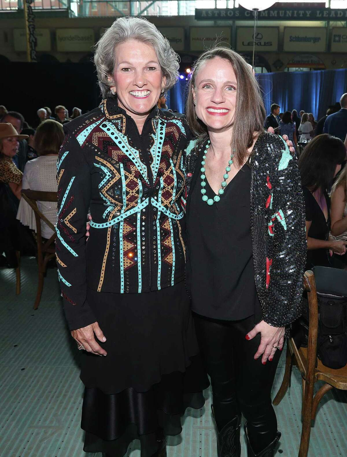 Twila Carter, left, and Nicole Cassier-Masonduring the Astros Foundation's sixth annual Diamond Dreams Gala presented by Chevron, featuring singer-songwriter and Texas native Lyle Lovett and his Large Band on the field at Minute Maid Park, Thursday, September 9, 2021, in Houston.