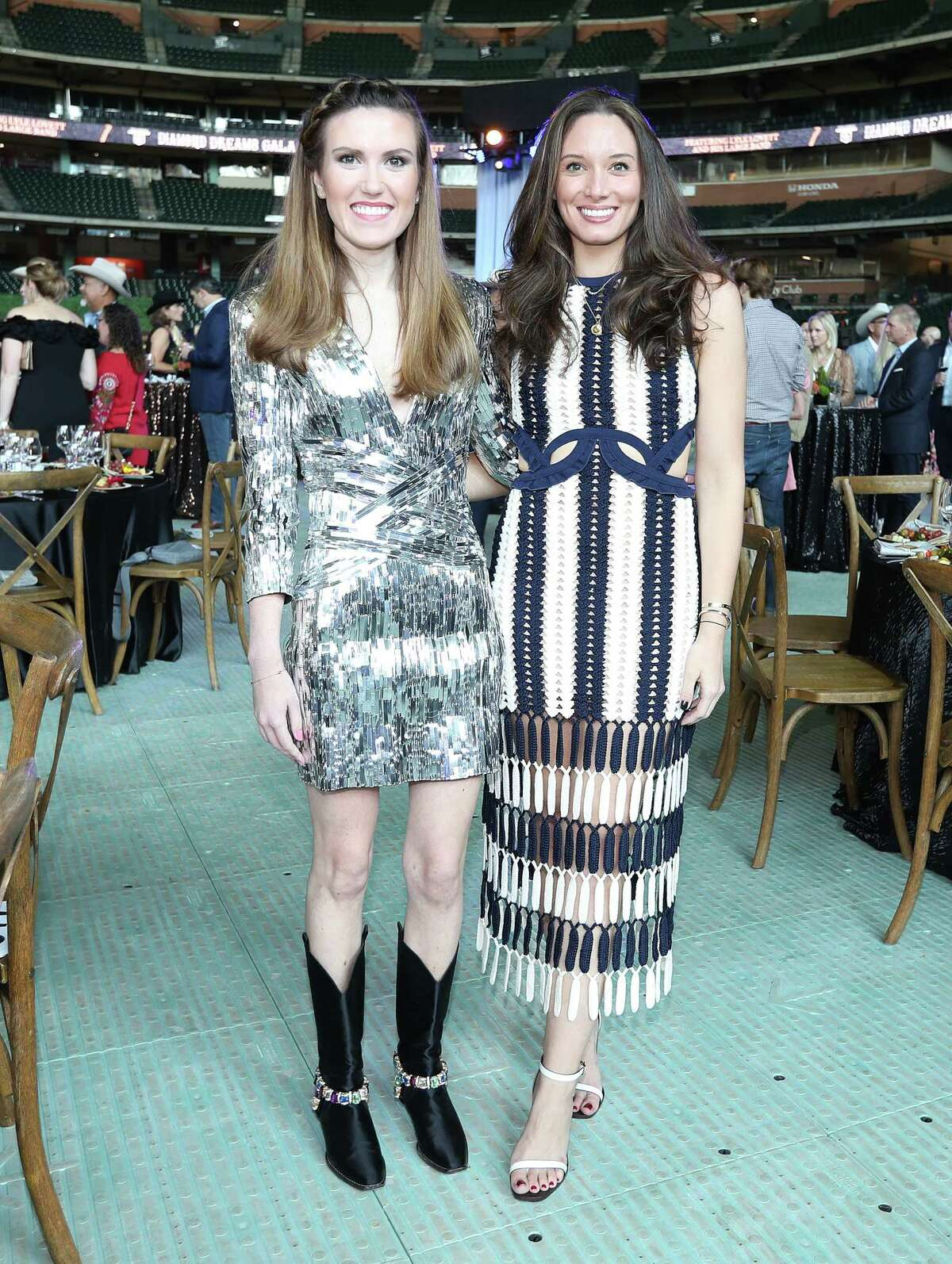 Heather Almond, left, and Kylie Bumgardner, right during the Astros Foundation's sixth annual Diamond Dreams Gala presented by Chevron, featuring singer-songwriter and Texas native Lyle Lovett and his Large Band on the field at Minute Maid Park, Thursday, September 9, 2021, in Houston.