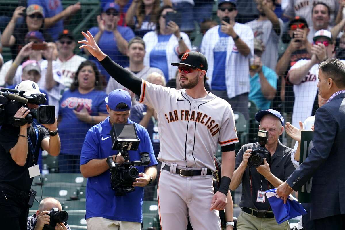 San Francisco Giants' Kris Bryant greets Chicago Cubs fans before a baseball game in Chicago, Friday, Sept. 10, 2021.