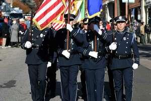 Greenwich Police march in the annual Veterans Day Patriotic Walk down Greenwich Avenue in Greenwich, Conn. Sunday, Nov. 11, 2018.