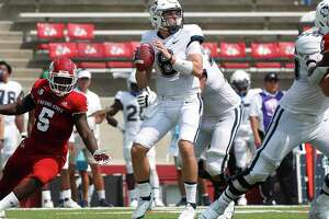 Connecticut quaterback Steven Krajewski looks for a receiver during the second half of the team's NCAA college football game against Fresno State in Fresno, Calif., Saturday, Aug. 28, 2021. (AP Photo/Gary Kazanjian)