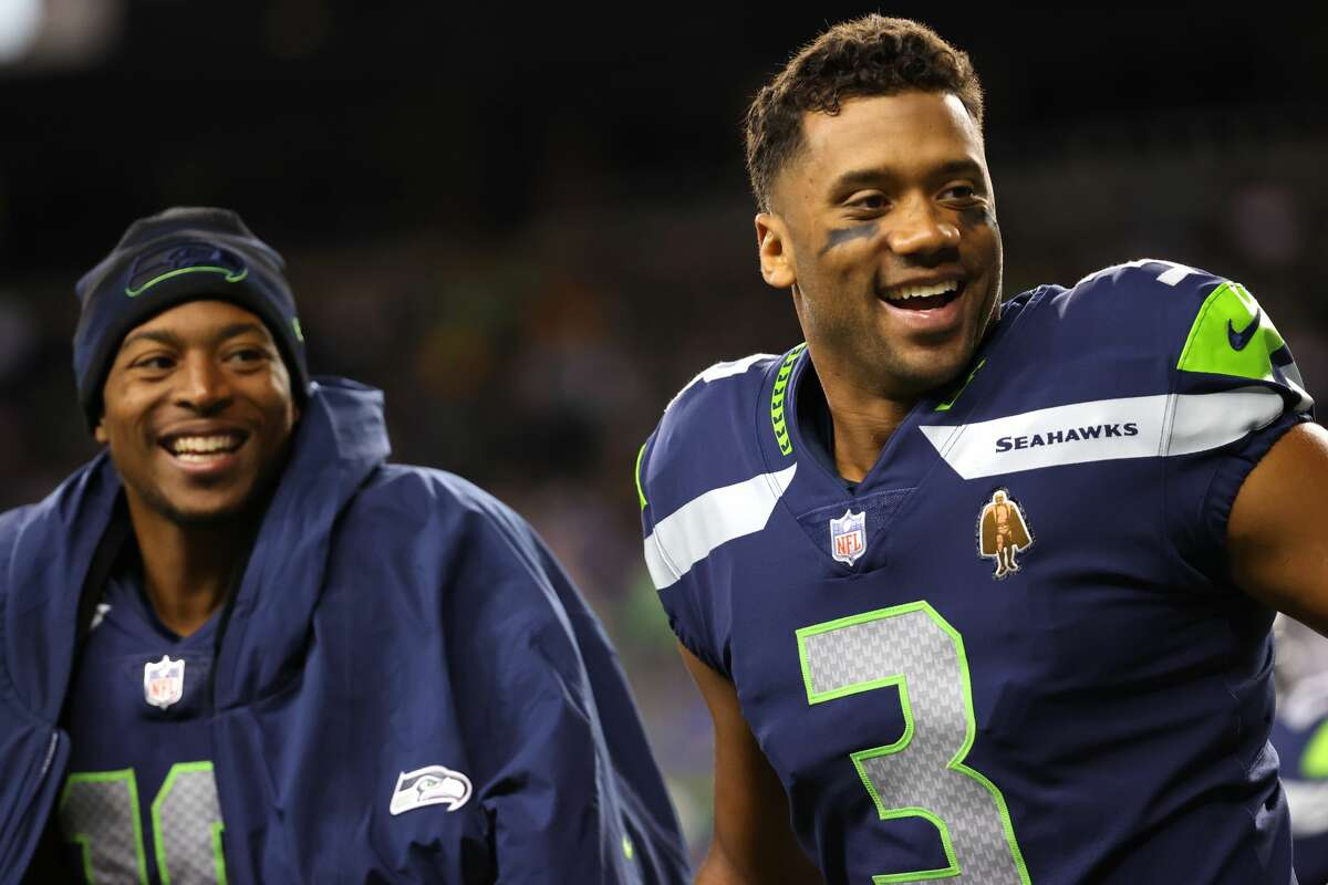 SEATTLE, WASHINGTON - AUGUST 28: Tyler Lockett #16 and Russell Wilson #3 celebrate the touchdown by Darece Roberson Jr #83 of the Seattle Seahawks during the fourth quarter during the NFL preseason game at Lumen Field on August 28, 2021 in Seattle, Washington.