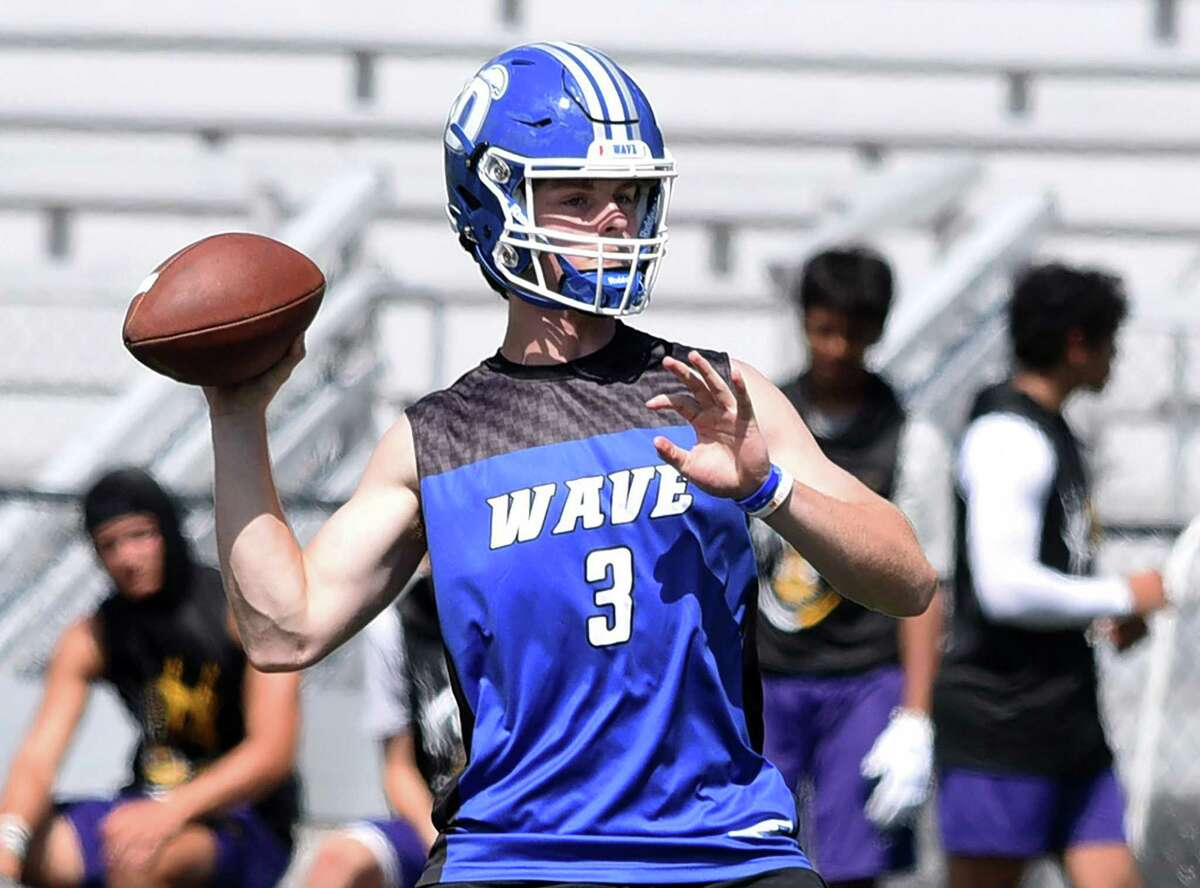 Darien's Miles Drake gets set to throw a pass on day one of the Grip It and Rip It football tournament in New Canaan on Friday, July 9, 2021.