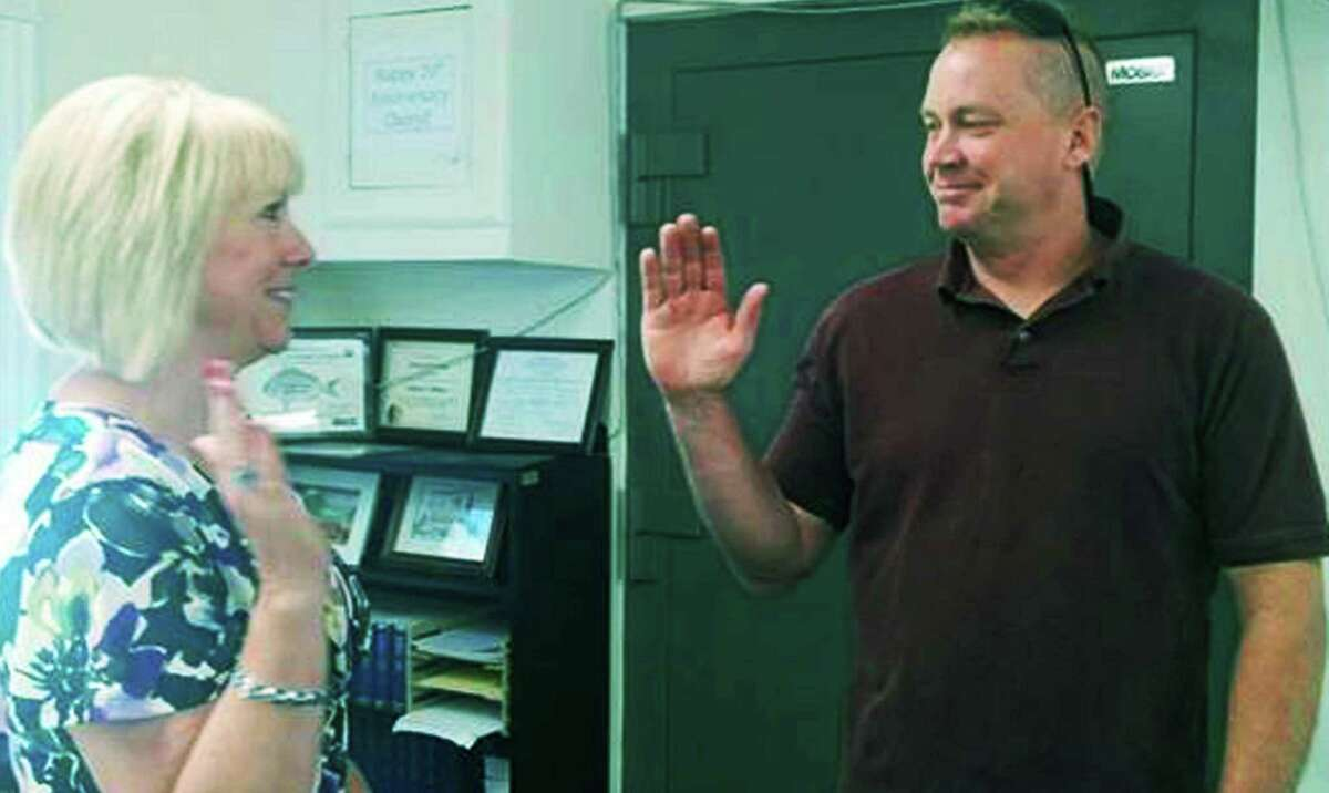 Officer Tim O'Hanlon, right, is sworn in June 24, 2015 as a new Bridgewater police officer by Town Clerk Cheryl Pinkos, who is running unopposed for reelection in 2021.