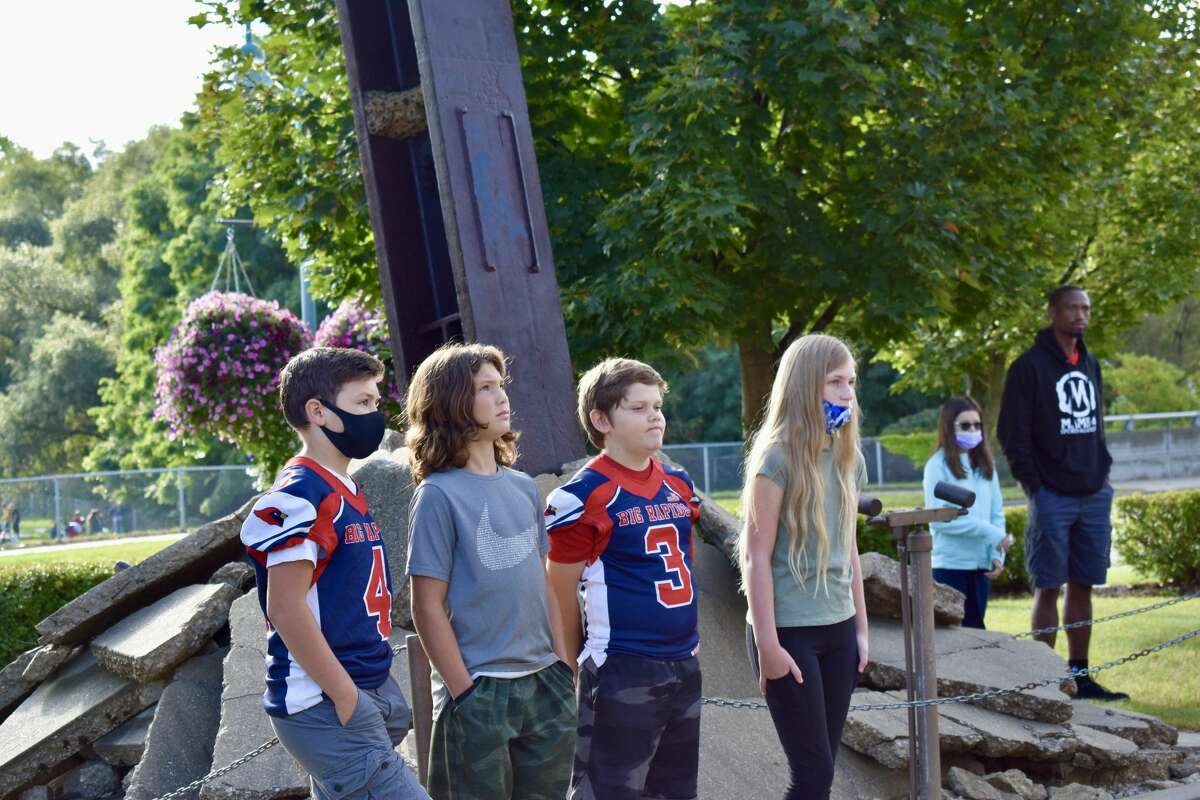 Students from Big Rapids Public Schools fifth grade classes visited the 9/11 memorial at the Department of Public Safety in downtown Big Rapids to learn more about the event, touch a piece of history, and watch the firing of a three-volley rifle salute and the playing of taps.