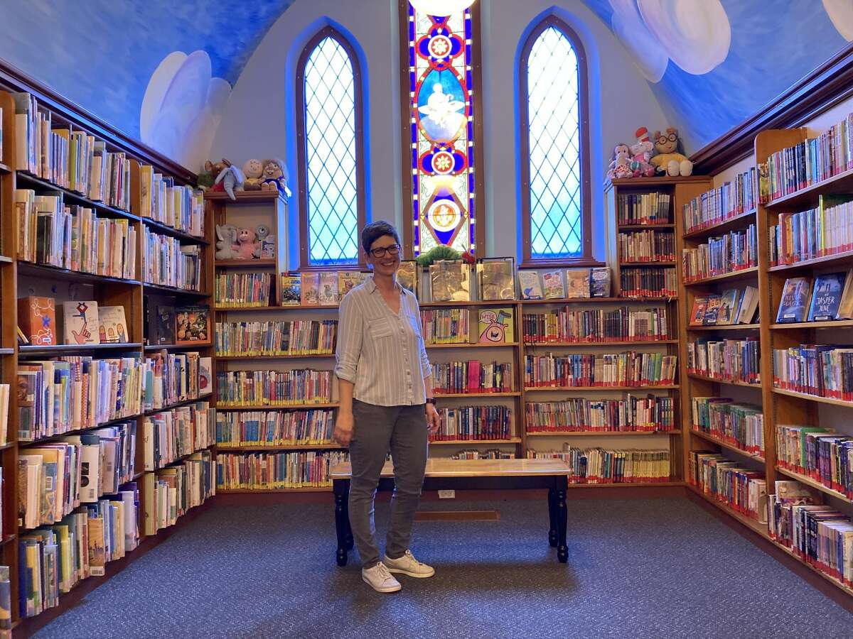 Stillwater Public Library Director Sara Kipp stands in the children's room, which is only large enough for a few children to attend storytime at once.
