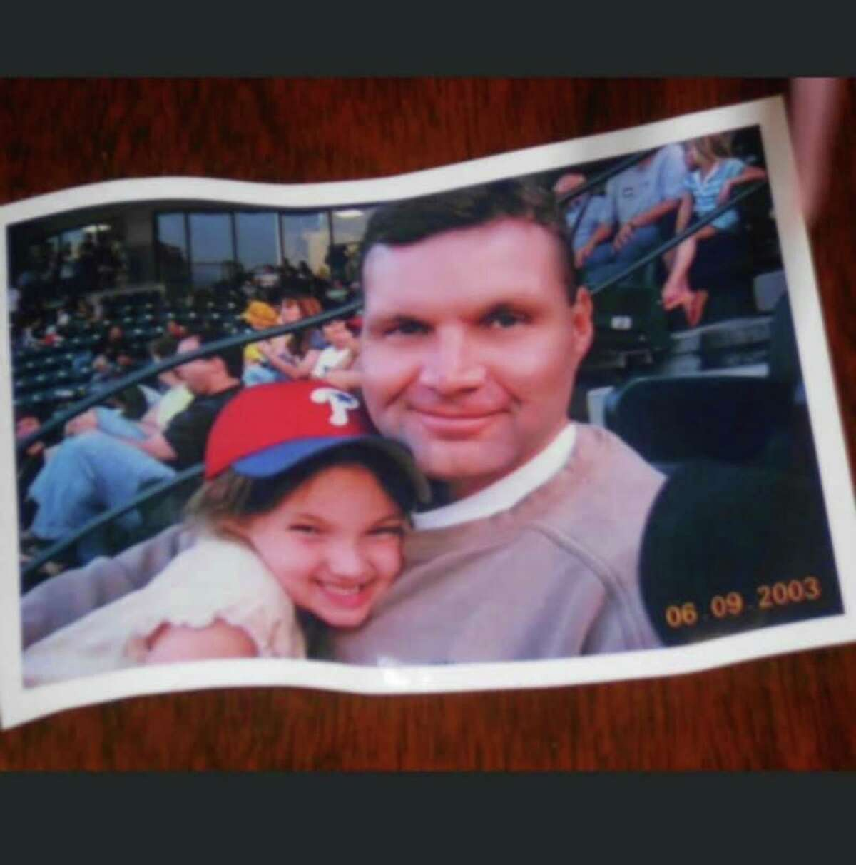 Eugene Baron with his daughter Maureen at a baseball game in 2003.