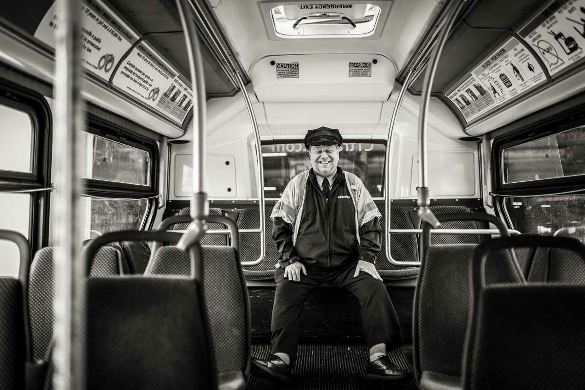 A CTtransit bus driver named George is one of the many frontline workers whose stories inspired photographer Ginny Kemp.