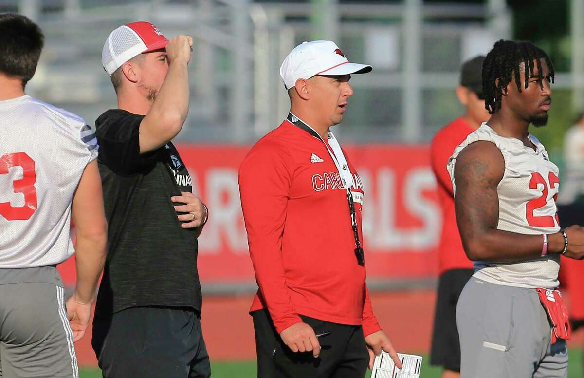 Head coach Eric Morris (center) oversees the team at UIW Cardinals' football practice on Thursday, Sept. 9, 2021.
