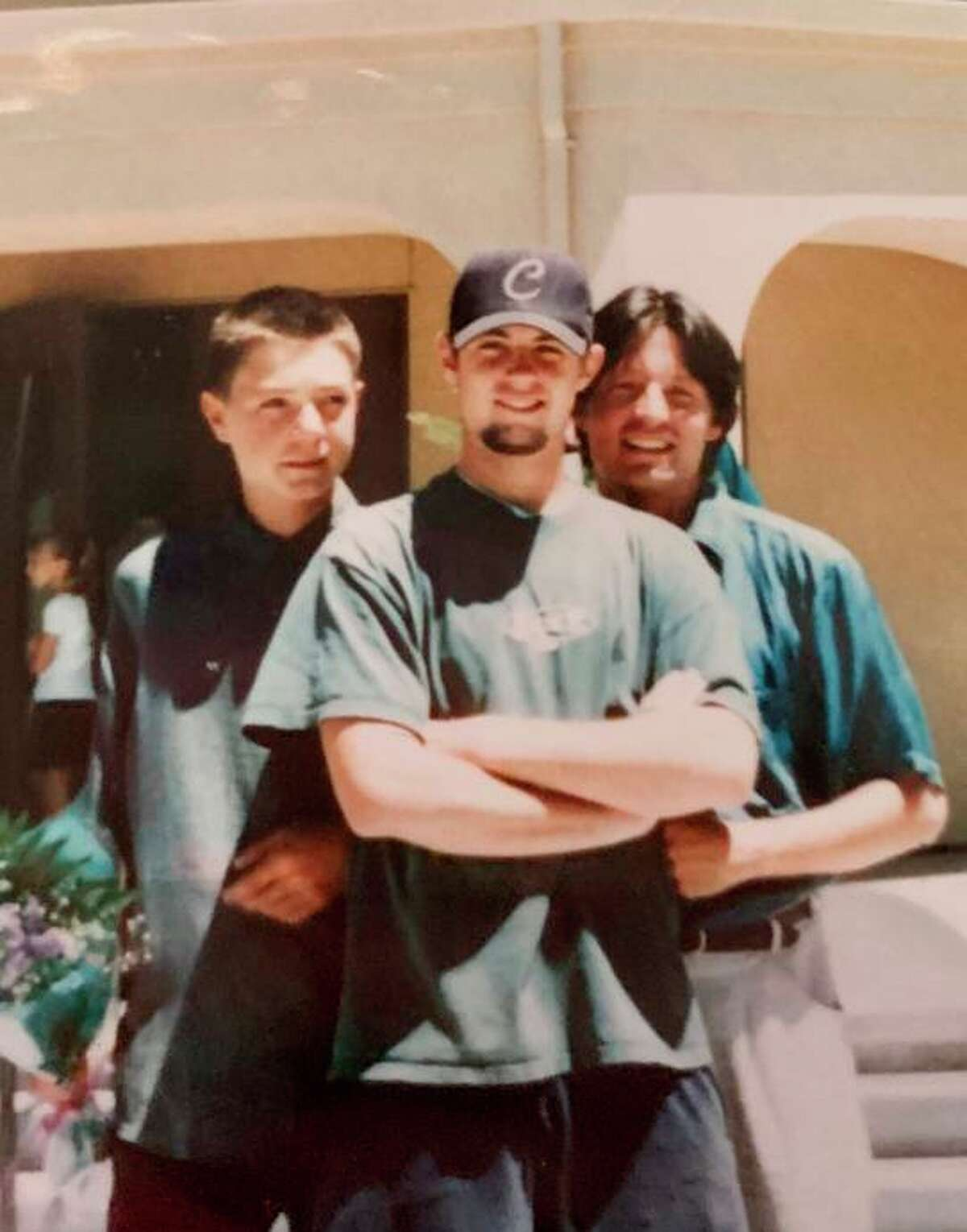 John Beaven (center) was 21 when his father, Alan (right), was killed during the Sept. 11 attacks.