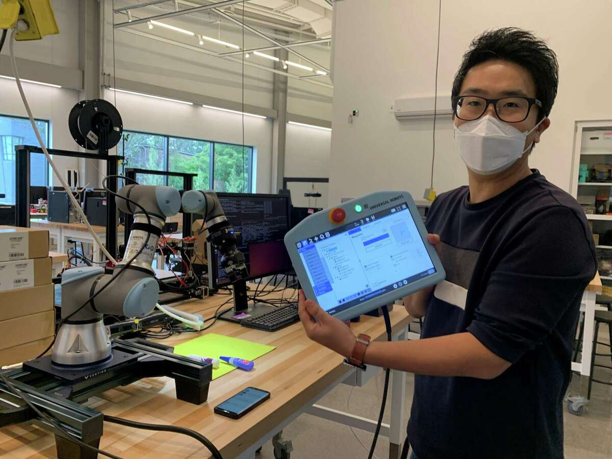 University of Hartford faculty member Kiwon Sohn shows off just some of the new robotics technolgoy the new building has to offer.