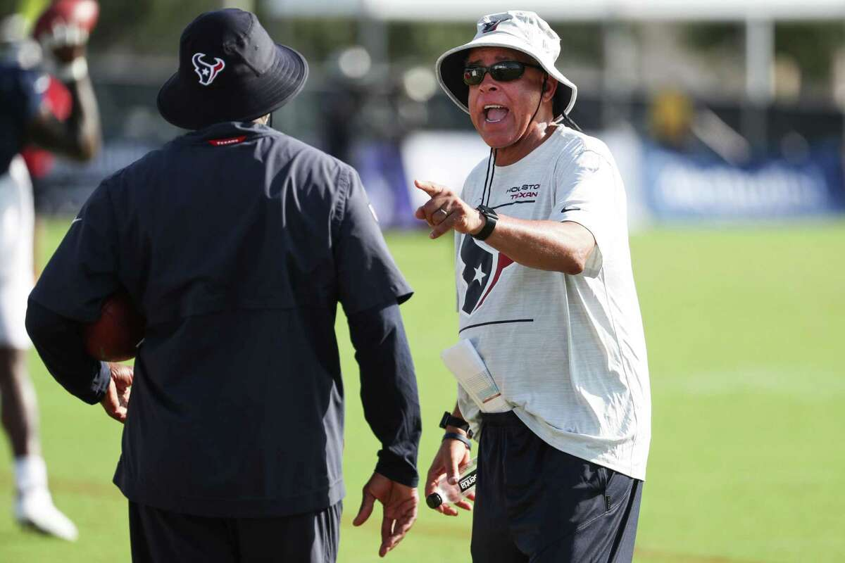 Houston Texans head coach David Culley talks to running backs coach Danny Barrett during an NFL training camp football practice Tuesday, Aug. 10, 2021, in Houston.