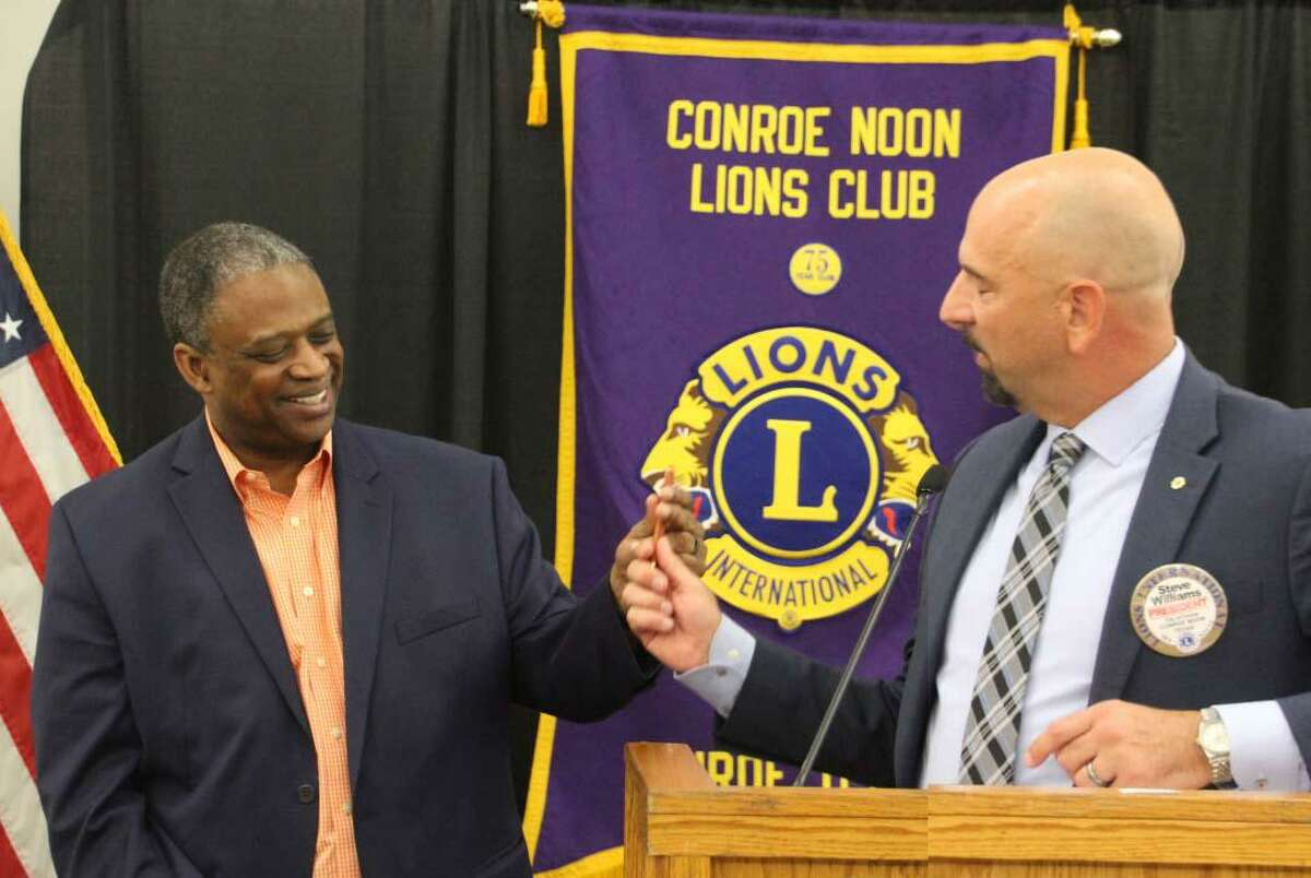 In remembrance of 9/11 the Conroe Noon Lions Club received a touching talk from 9/11 survivor Ted Bell, left, at last week's club meeting; President Steve Williams, right, thanks him by presenting him with a coveted Conroe Noon Lions Club pen.