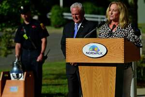 Kathryn Hebert speaks about her brother, Adam Lewis, who died in the 9/11 attacks, as The City of Norwalk holds their 9/11 20th Year Remembrance Ceremony outside city hall Friday, September 10, 2021, in Norwalk, Conn.