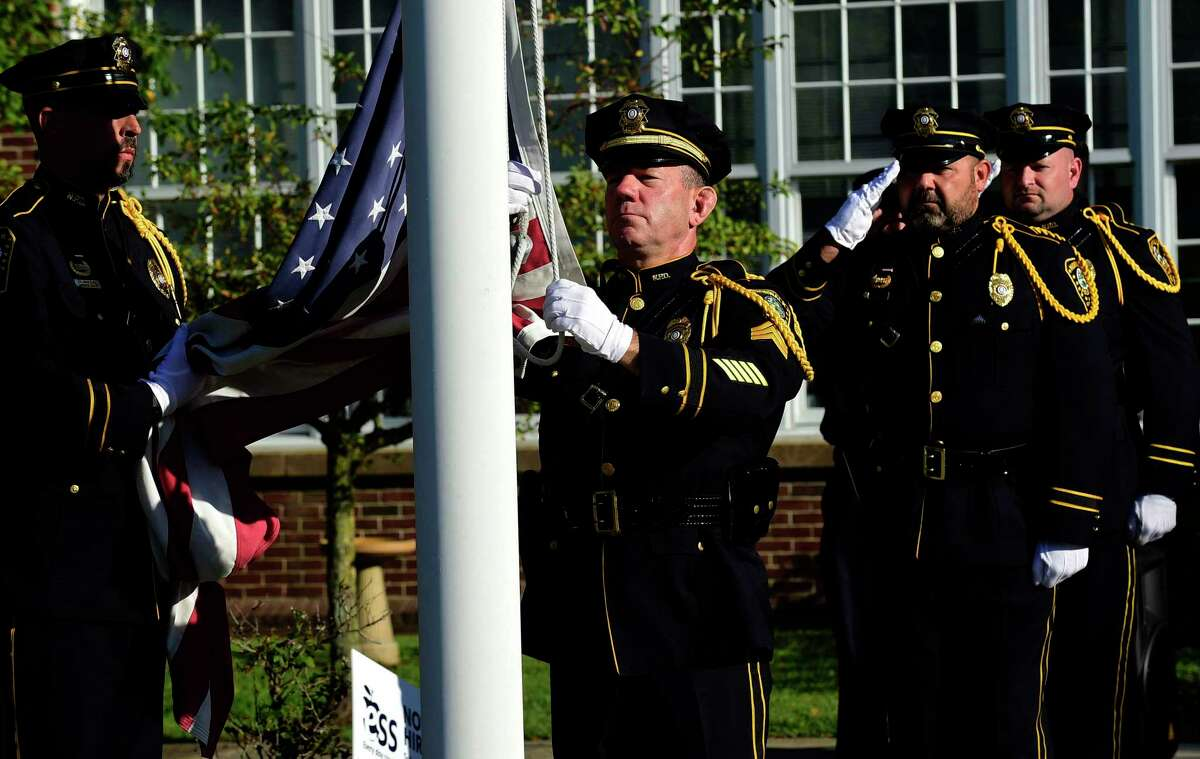 The Norwalk Police Department Honor Guard retires the colors as The City of Norwalk holds their 9/11 20th Year Remembrance Ceremony outside city hall Friday, September 10, 2021, in Norwalk, Conn.
