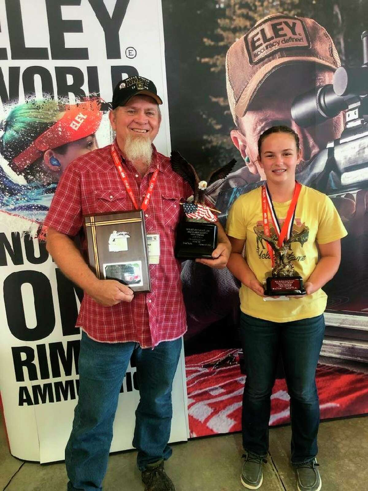 Lily Mortensen (right) and her coach Bill Litz enjoy the hardware received for a national title. (Courtesy photo)