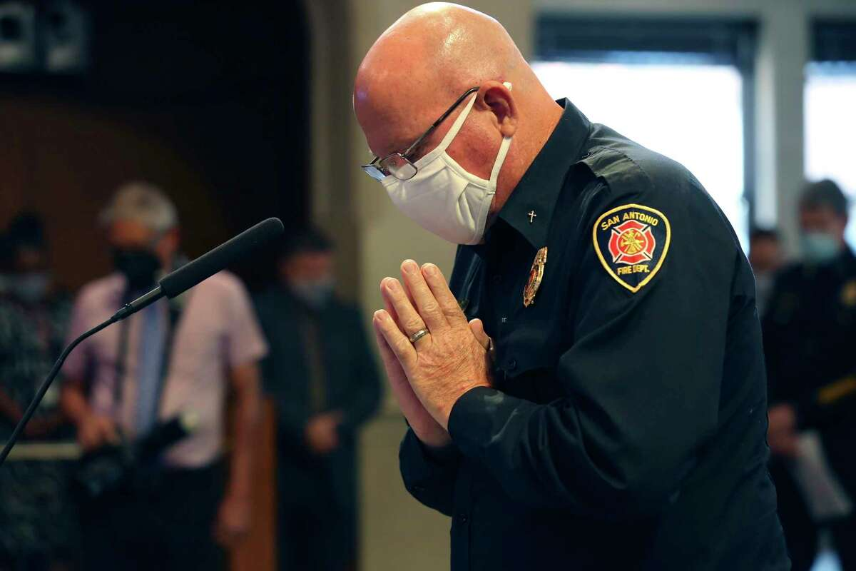 San Antonio Fire Department Head Chaplain Jerry Whitley says a prayer during a 9/11 Remembrance Ceremony during a San Antonio City Council meeting, Thursday, Sept. 9, 2021.