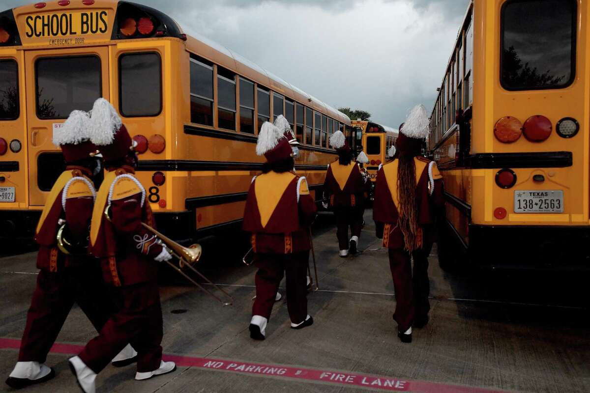 Beaumont United's band make their way to the buses after the first lightning delay during the season opening Alumni Bowl game Friday at BISD Memorial Stadium. Photo made Friday, August 27, 2021 Kim Brent/The Enterprise