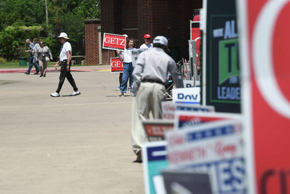 Candidates and campaign workers work the entry to the Rogers Park polling site on the second day of early voting. Photo made Tuesday, April 20, 2021 Kim Brent/The Enterprise